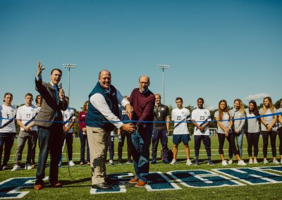 Ribbon-cutting at the new Brigham turf field and track, with Jon Tymann and Foster Chase
